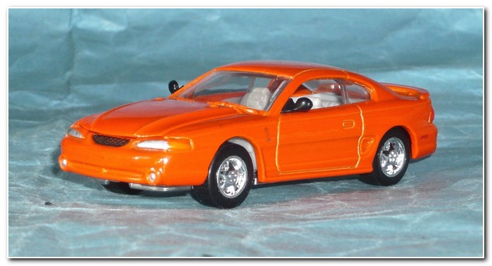 4th gen Mustang 1997 illustration 28 Racing Champions Cobra coupe - orange